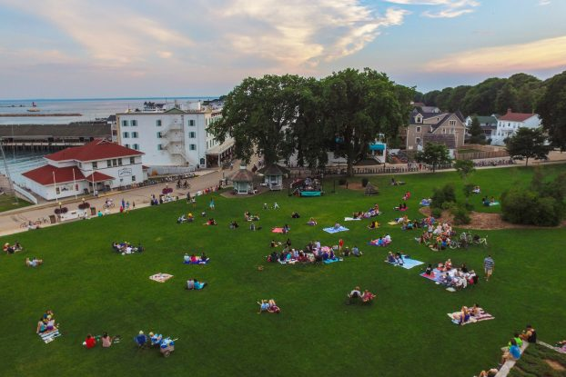 Basking in Music: The park below Fort Mackinac fills with music lovers in the summer. (Photo/Sam Staffan)