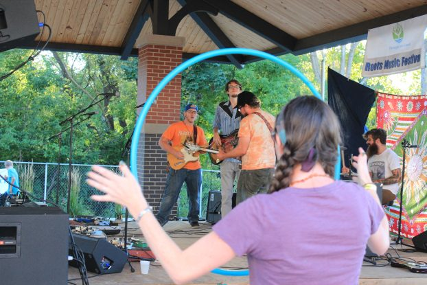 Big Dudee Roots: Framed by a hula hooper, Big Dudee Roo performed Saturday at the Barry County Roots Music Fest. (Photo/Anna Sink)