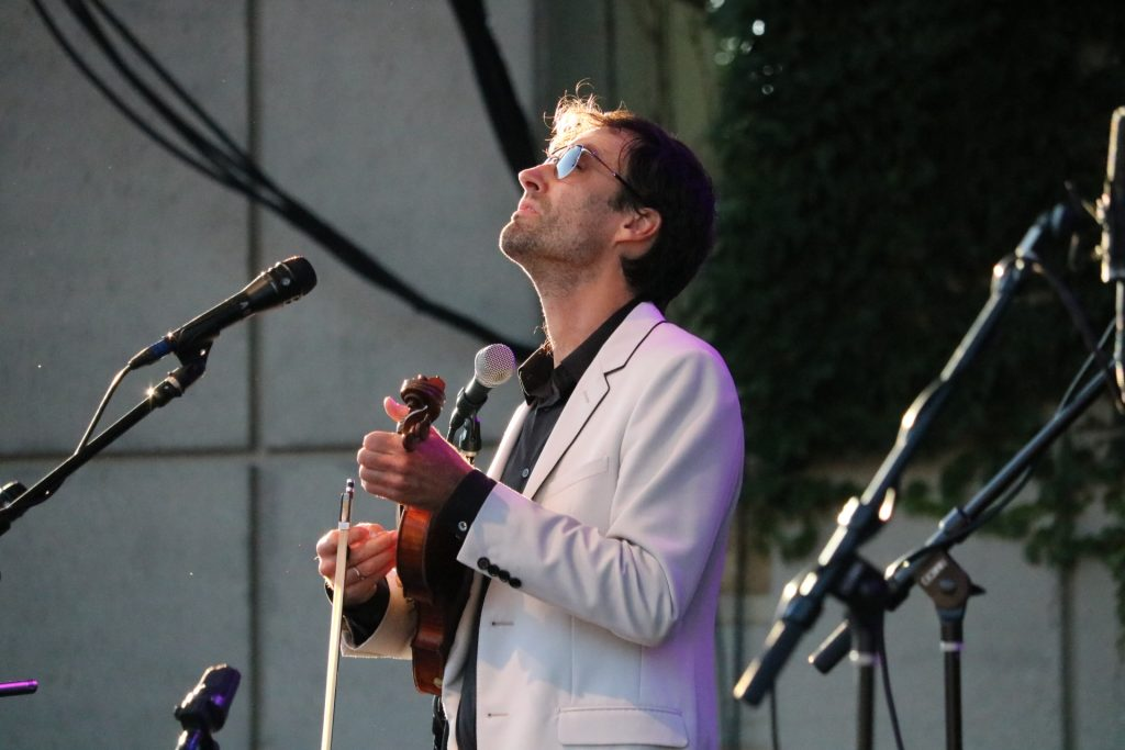 Andrew Bird whistles, fiddles, strums, loops and croons way into Grand Rapids fans' hearts