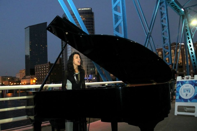 Bridge to the Top: Amanda Vernon won the pop/electronic category in the song contest hosted by St. Cecilia Music Center. She performed last week on the Blue Bridge. (Photo/Kathy Barth)