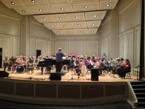 Chris Hansen directed a very big band at St. Cecilia during the showcase.
