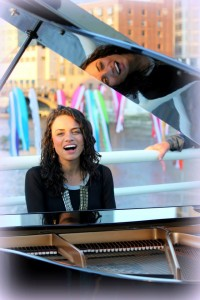 Blue Bridge Pop: Vernon performed outdoors on a grand piano as part of an ArtPrize appearance. (Photo/Kathy Barth)