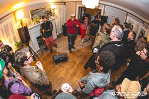 Lady Ace Boogie: Writer Brian J. Bowe, at right, in the living room crowd at Lamp Light. (Photo/Anthony Norkus)