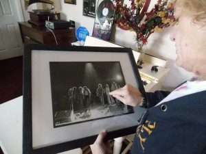 Silver Bullet Days: Robins checking out a photograph of himself on stage with the Silver Bullet Band. (Photo/Local Spins)