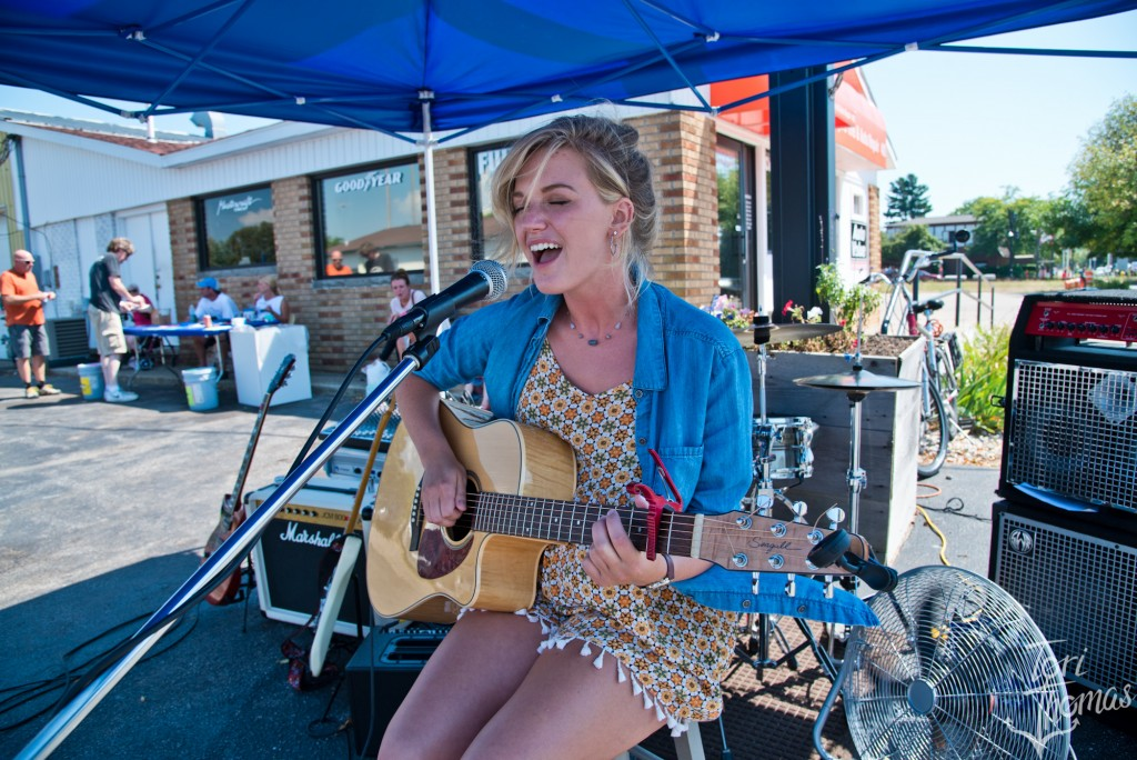 Singing the Song, Walking the Beat: Loren Johnson was one of 60 acts playing temporary stages across Grand Haven on Saturday. (Photo/Tori Thomas)