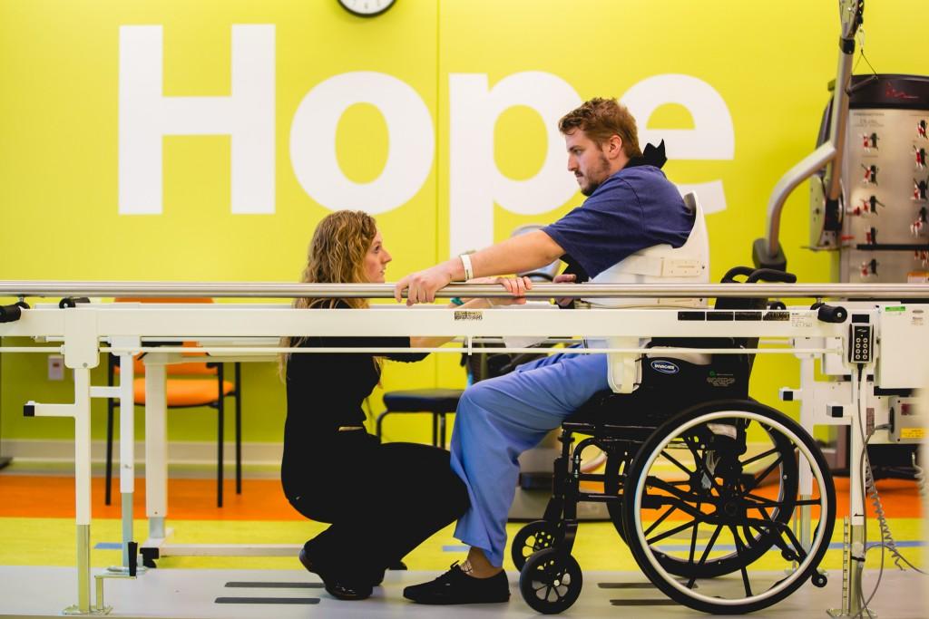Moving Forward: Drummer Andrew Tkaczyk with physical therapist Megan Kaiser at Mary Free Bed Rehabilitation Hospital. (Photo/Anthony Norkus, Courtesy of Mary Free Bed)