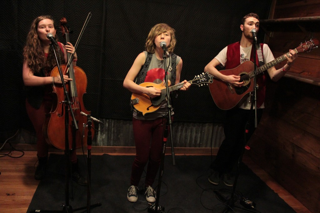 "Beautiful Noise: The Accidentals recording their song in the ""studio"" behind Michigan House-Austin. (Photo/Anna Sink)"