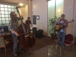 Banking On It: Max Lockwood, Daine Hammerle and Nate Wagner of Big Dudee Roo performing Wednesday morning in a Grand Rapids bank.