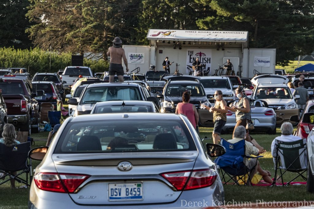 Packed parking lot, gleeful Beatles fans greet Gilmore Car Museum's drive-in concert